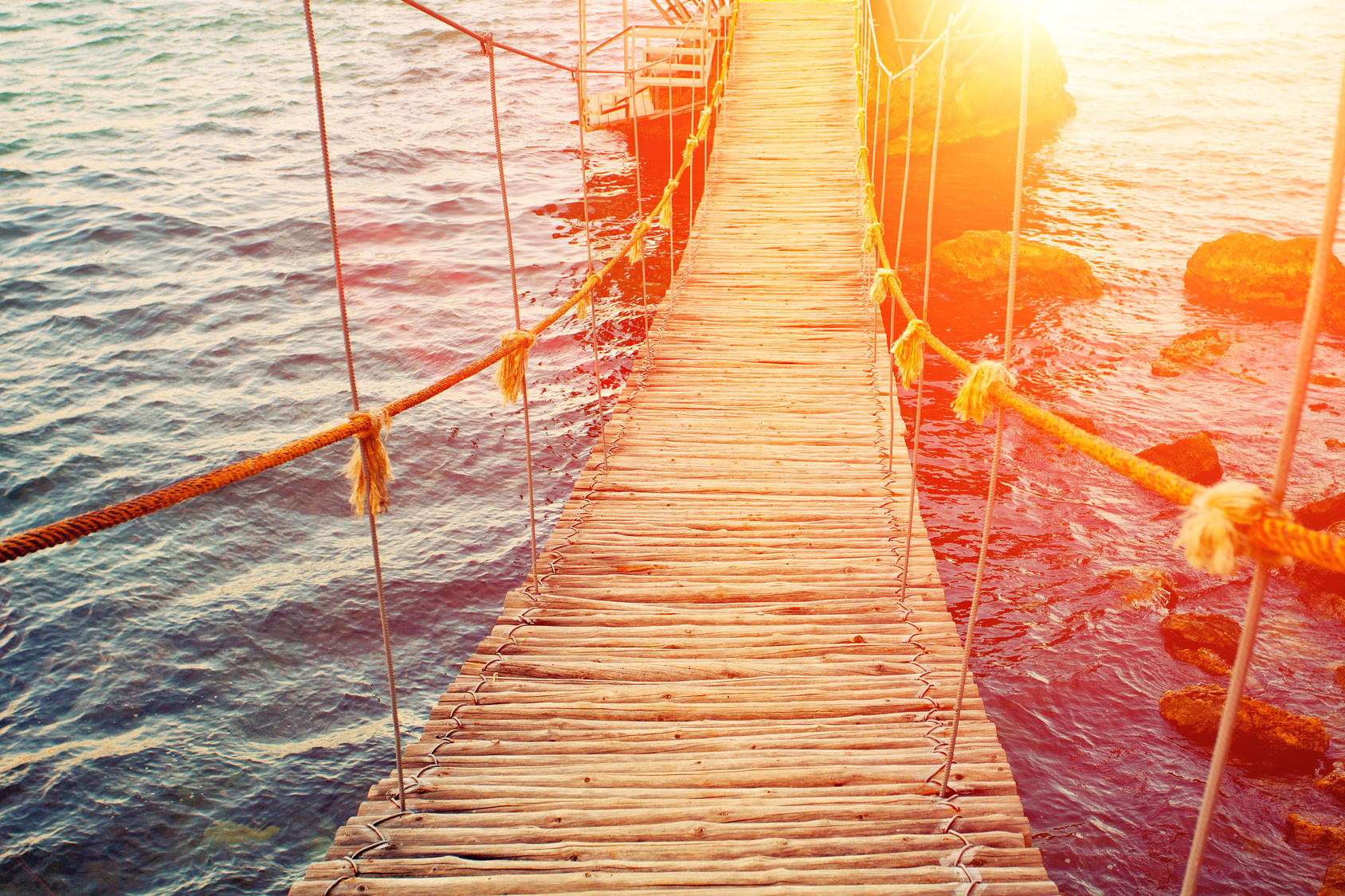 Rope bridge at sunset